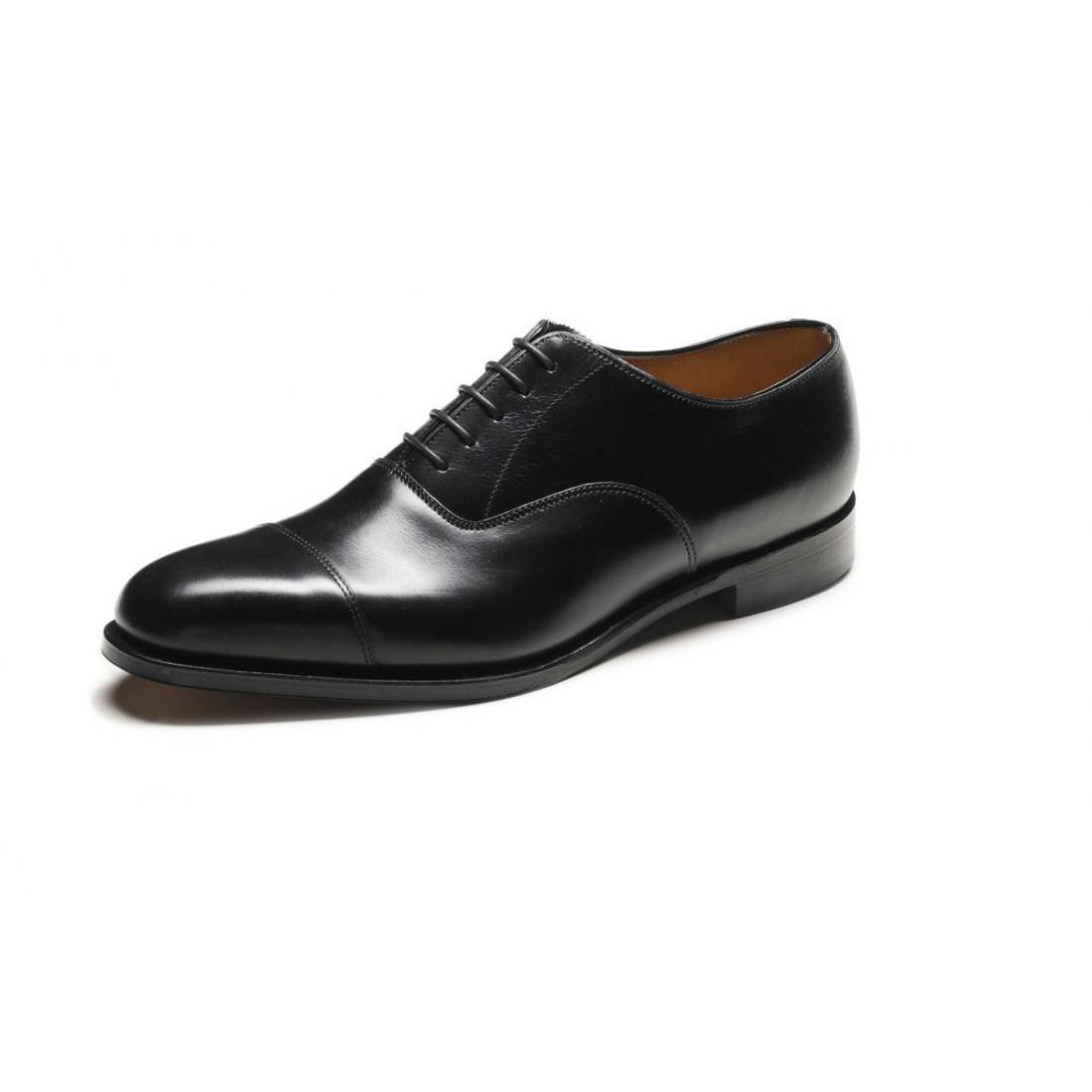 These black leather oxford shoes have a sleek pointed toe and stacked sole. By Shellys London.